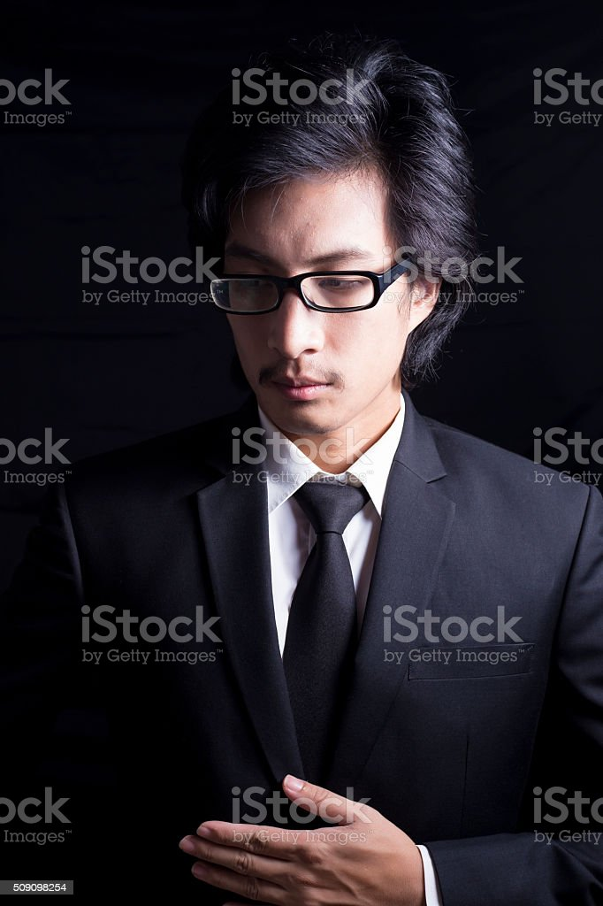 Businessman with His Hand on Stomach stock photo