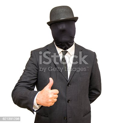 Businessman with with his head hidden by a balaclava turned and a hat and with thumb raised as a sign that all is well on white background