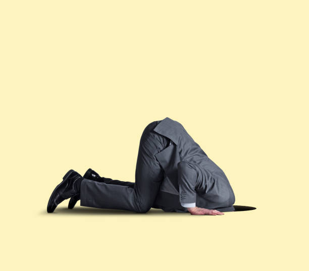 Businessman With His Head In A Hole stock photo
