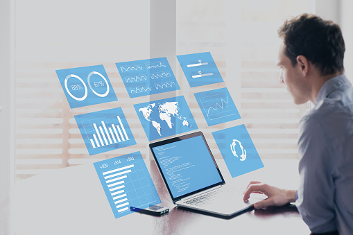 Businessman with holographic AR screen business analytics financial dashboard, fintech