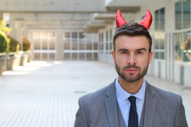 Businessman with horns close up stock photo