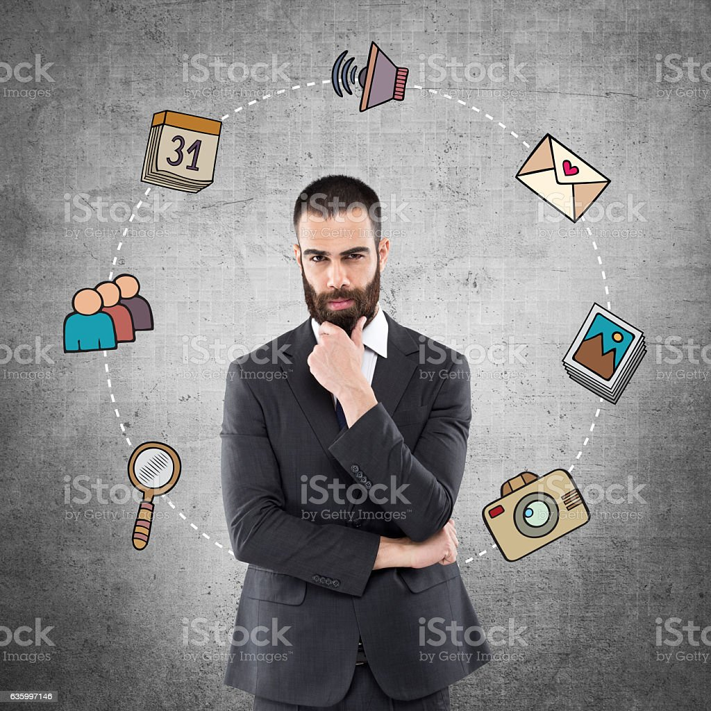 Businessman with infographic icons stock photo