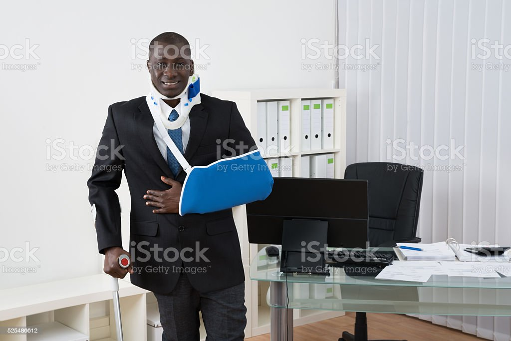 Businessman With Injuries In Office stock photo