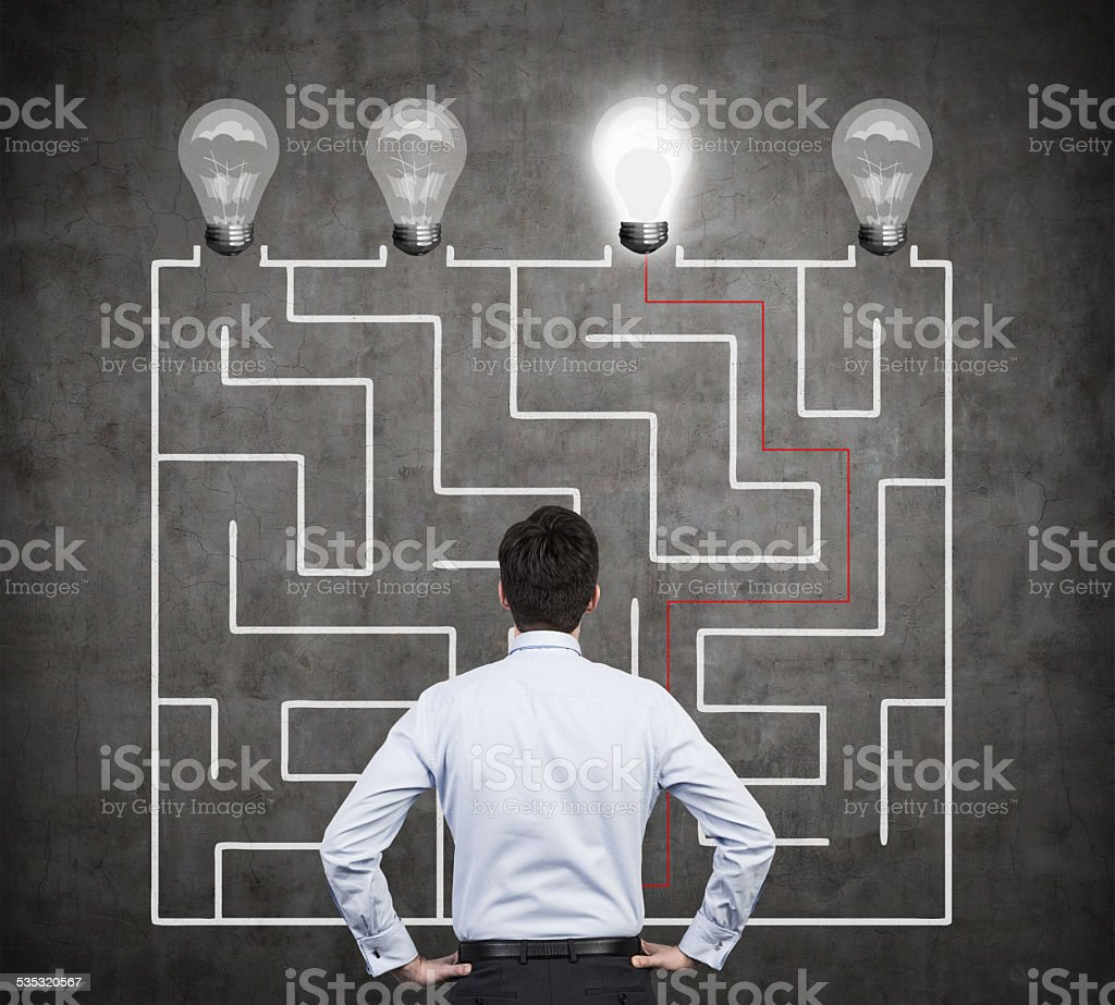 businessman with lamp and maze stock photo