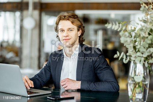 1128886313 istock photo Businessman with lapptop indoors 1151342401