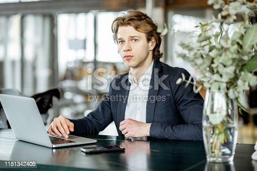 1128886313 istock photo Businessman with lapptop indoors 1151342405