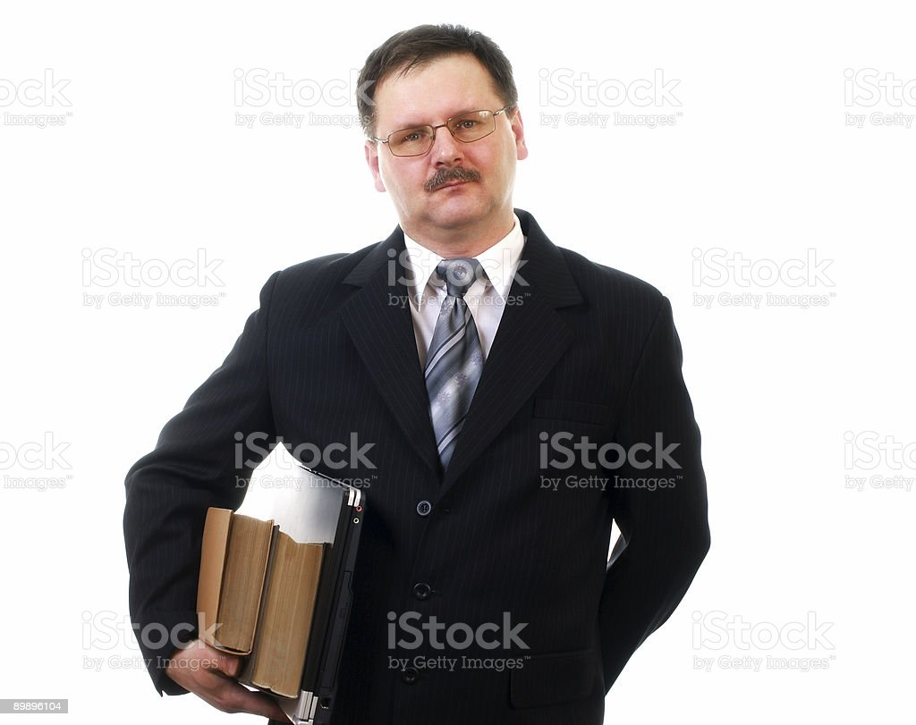 Businessman with laptop and books royalty-free stock photo