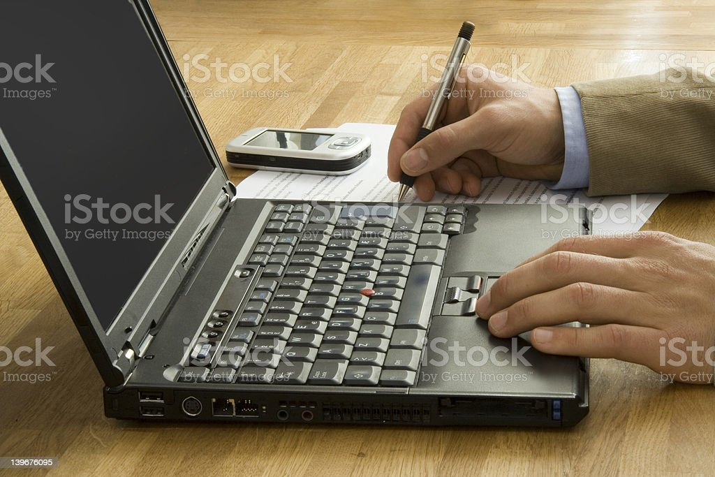 Businessman with laptop and Handheld royalty-free stock photo