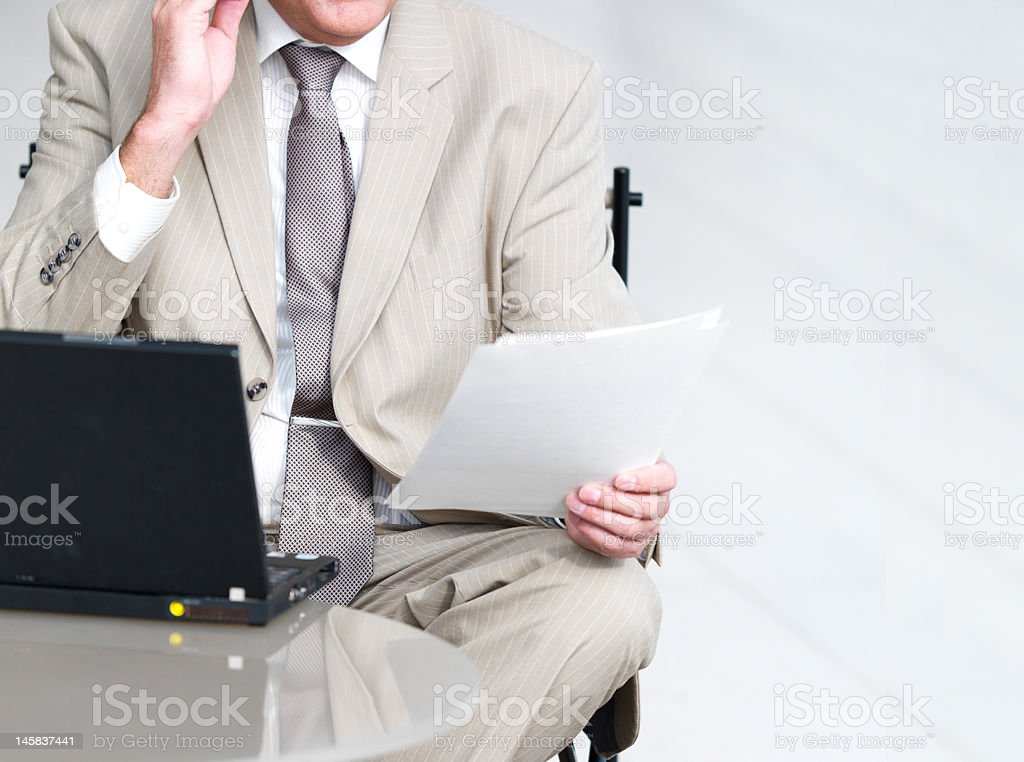Businessman with laptop and paper royalty-free stock photo