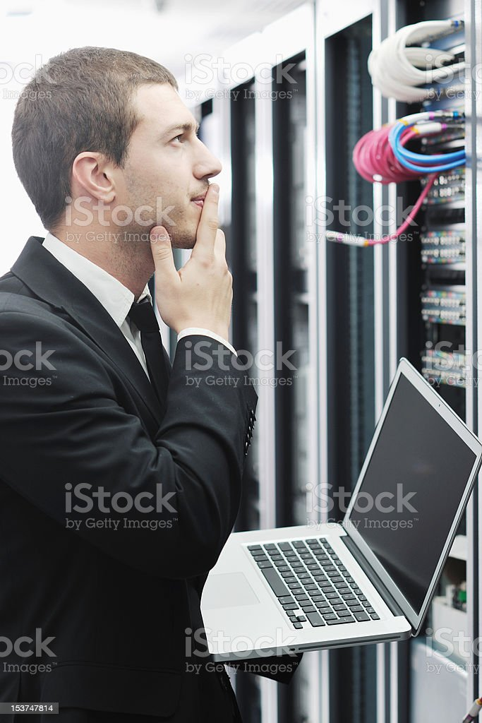 businessman with laptop in network server room royalty-free stock photo
