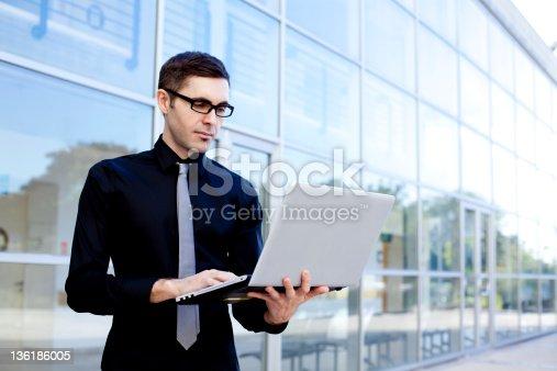 1024730528 istock photo Businessman with laptop 136186005