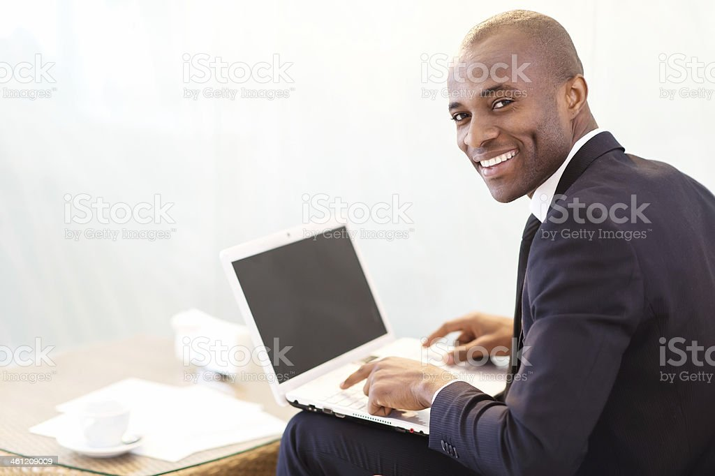 Businessman with laptop. stock photo