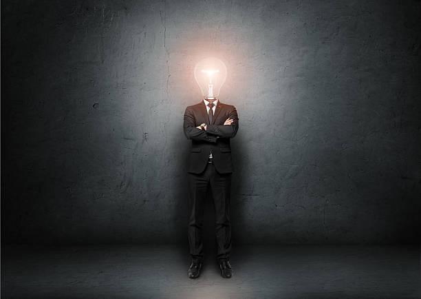 businessman with light bulb instead of head on concrete room - 被砍頭 個照片及圖片檔