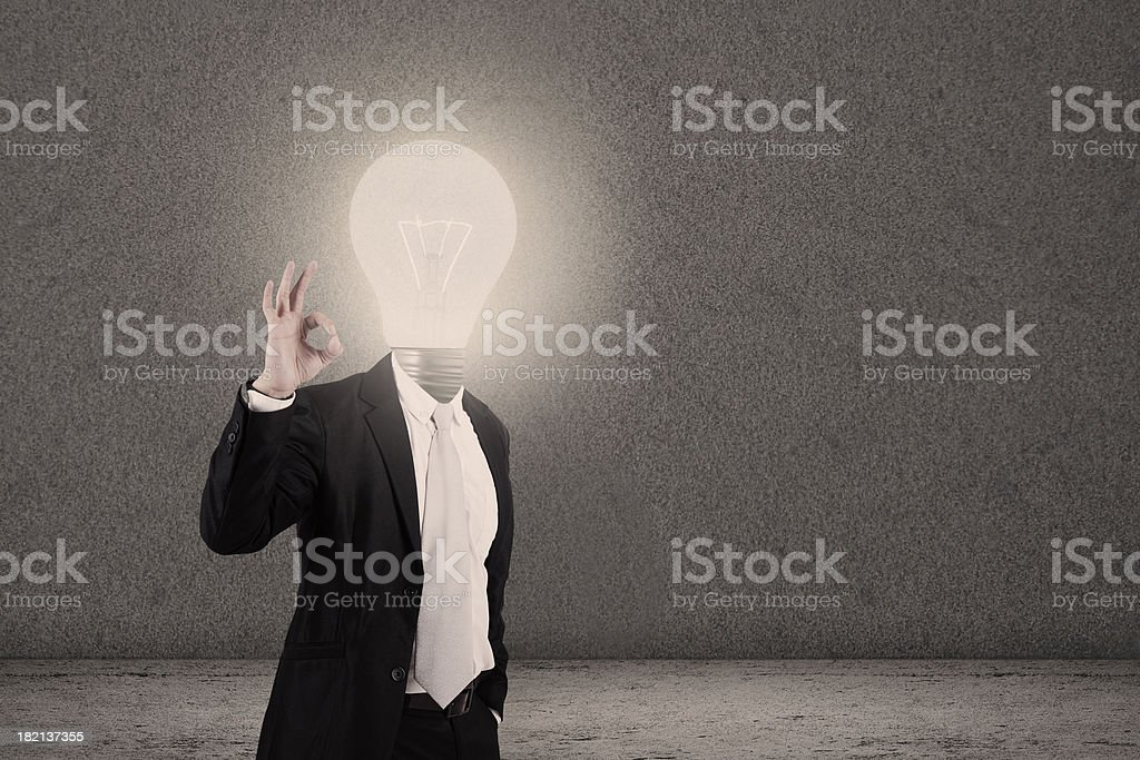 Businessman with lightbulb head and OK sign royalty-free stock photo