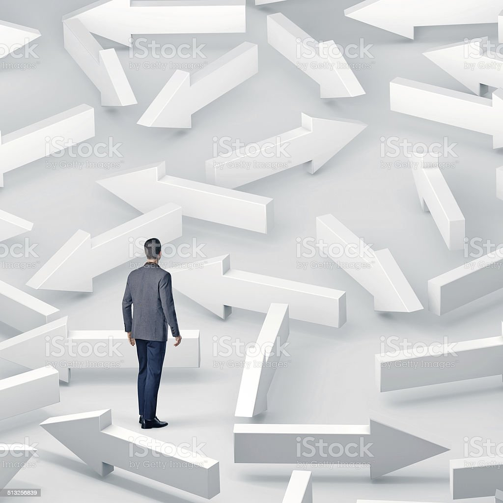 Businessman with lots of choices stock photo