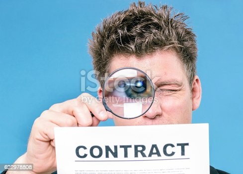 istock Businessman with magnifying glass 622978808