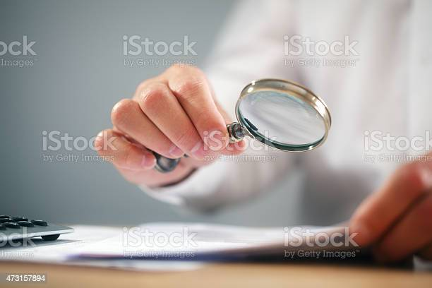 Businessman with magnifying glass reading documents picture id473157894?b=1&k=6&m=473157894&s=612x612&h=fczbco6veiof 2rg2td20ufzt33fmuglwerlwfhnno8=