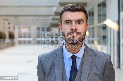 istock Businessman with mandibular prognathism close up 1006896316