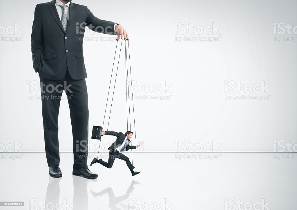 Businessman with marionette stock photo