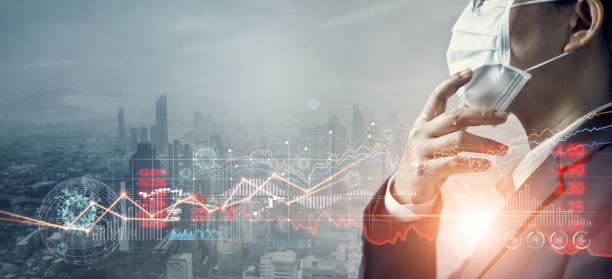 Businessman with mask, Analysis coronavirus impact on global economy and stock markets, Effects of outbreak and pandemic covid-19, Economy crisis, Stocks fall and financial crisis. stock photo