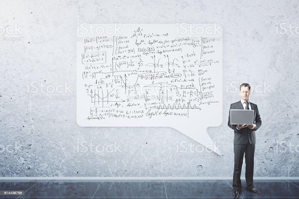 Businessman with mathematical formulas stock photo