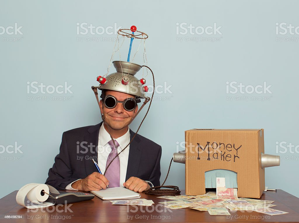 Businessman with Mind Reading Machine Makes Money stock photo