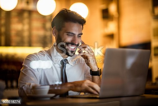 istock Businessman with mobile phone and laptop inside coffee shop 503518274