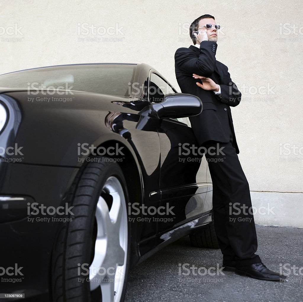 businessman with mobile phone at his car royalty-free stock photo