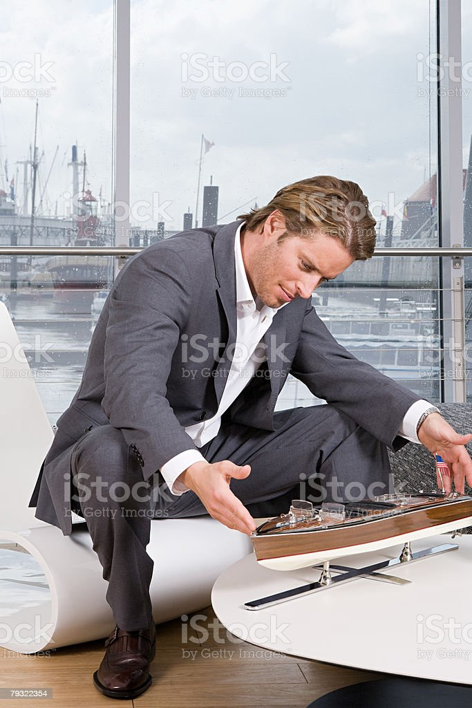 Businessman with model boat 免版稅 stock photo