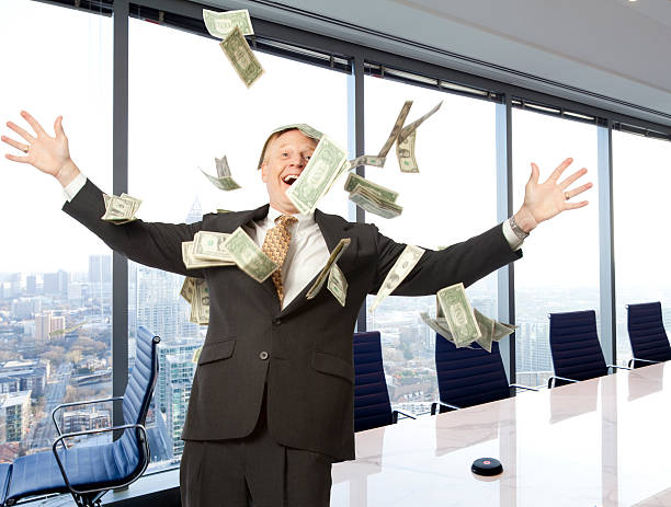 businessman with money - hoarding stock photos and pictures