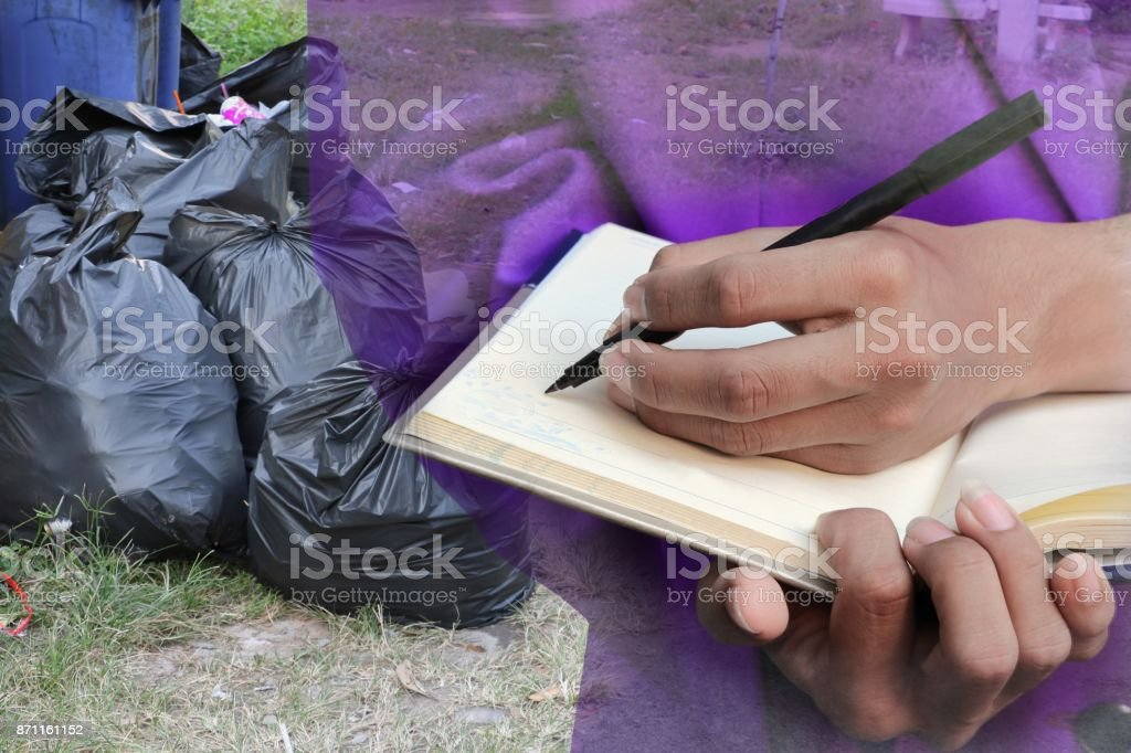 businessman  with notepad  hand signing documents in garage, double exposure concept stock photo