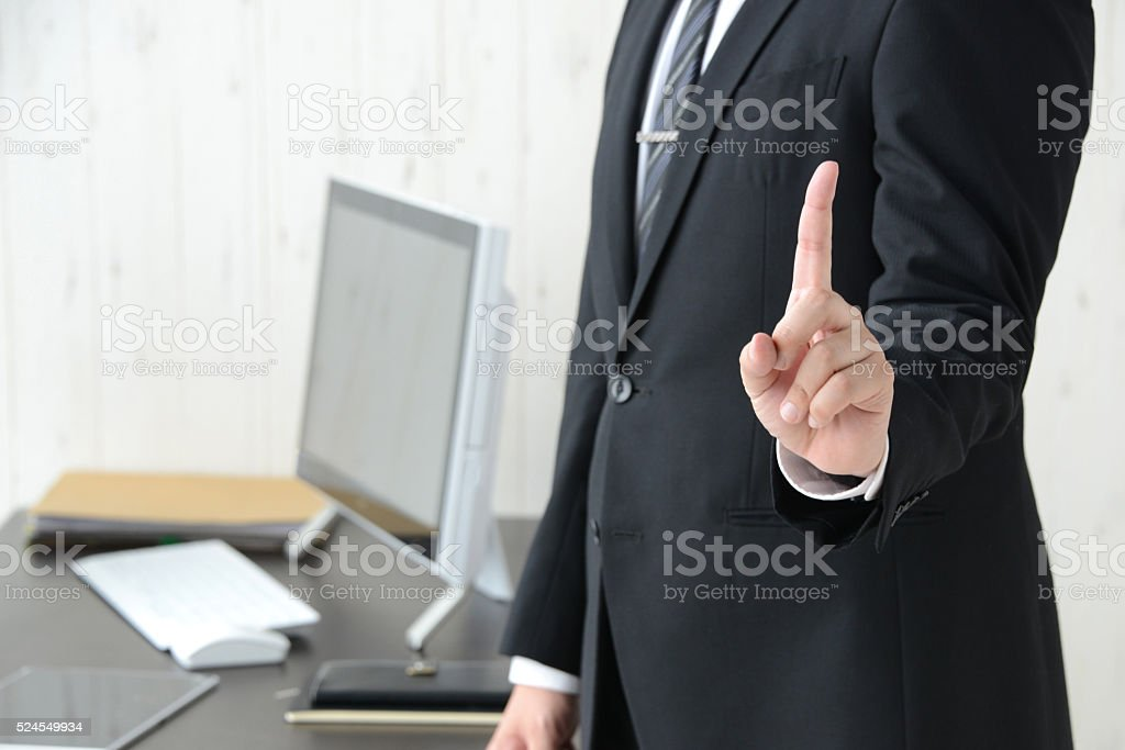 Businessman with number one sign stock photo