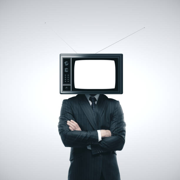 Businessman with old TV instead stock photo