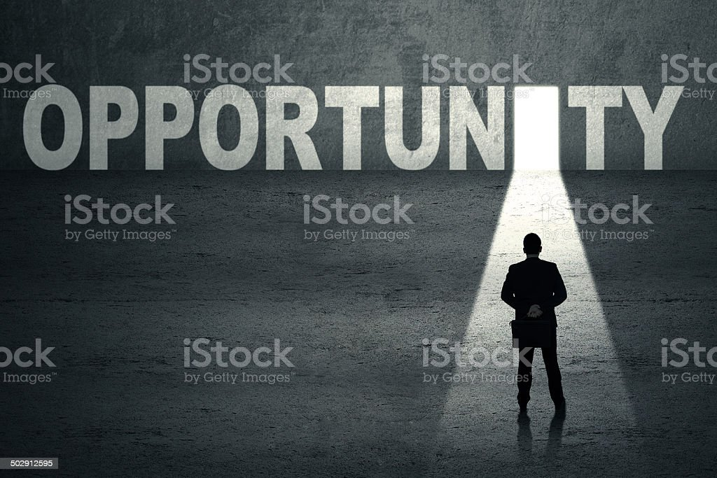 Businessman with opportunity door stock photo