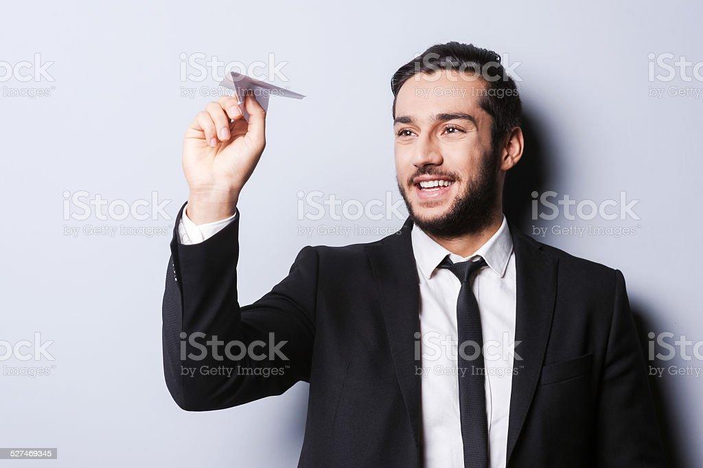 Homme d'affaires avec Avion en papier. - Photo