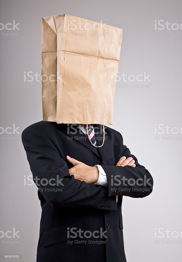 Businessman with paper bag on his head royalty-free stock photo