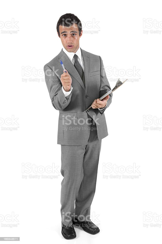 Businessman with pen and clipboard royalty-free stock photo