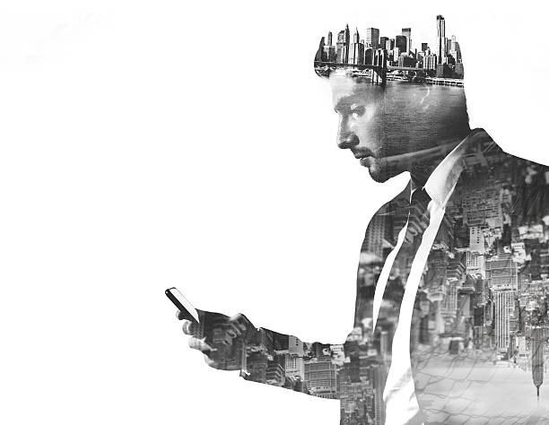 businessman with phone double exposed with city images - dubbelopname businessman stockfoto's en -beelden
