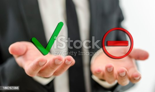 Closeup of businessman making decision whether to accept or deny a suggestion or employee.