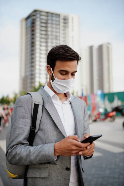 Businessman with protective face mask stock photo