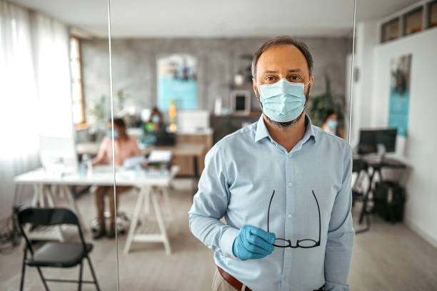businessman with protective gloves and face mask at office - businessman covid mask foto e immagini stock