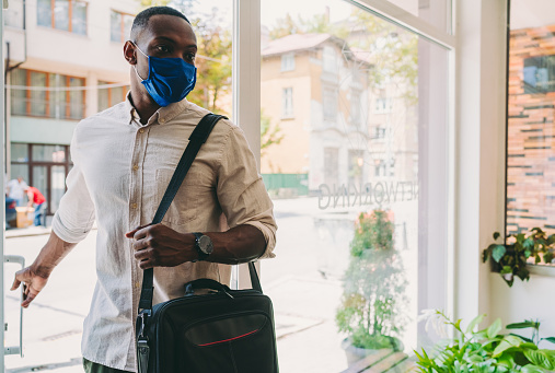 Businessman with mask is going to work during COVID-19 pandemic