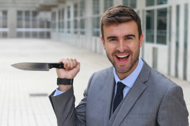 businessman with psychopathic behaviors - killer stock photos and pictures