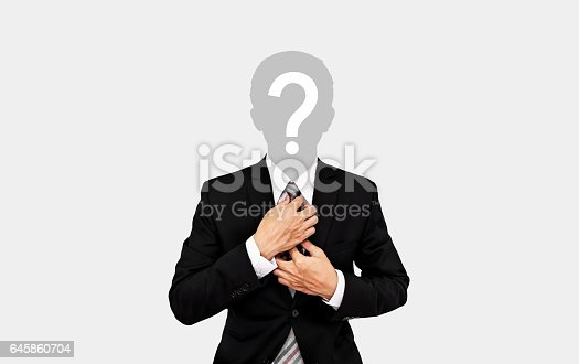 istock Businessman with question mark on head, on soft grey background 645860704