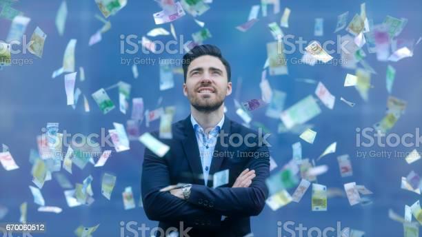 Businessman With Raining Banknotes - Fotografie stock e altre immagini di A mezz'aria