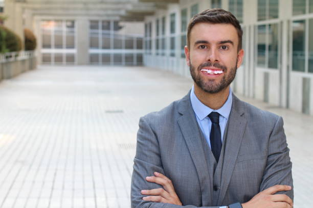 businessman with really bad teeth - cultures stock photos and pictures