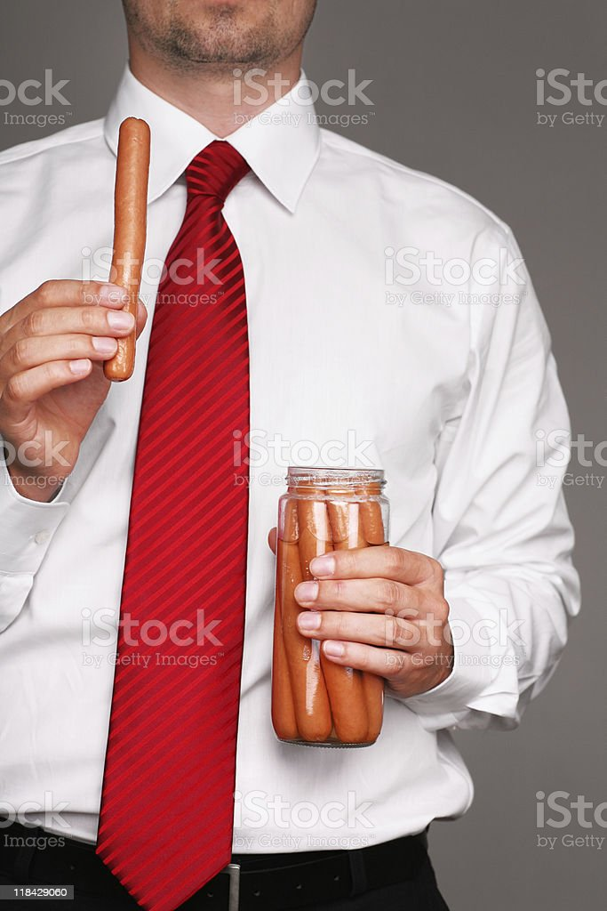 businessman with sausages royalty-free stock photo
