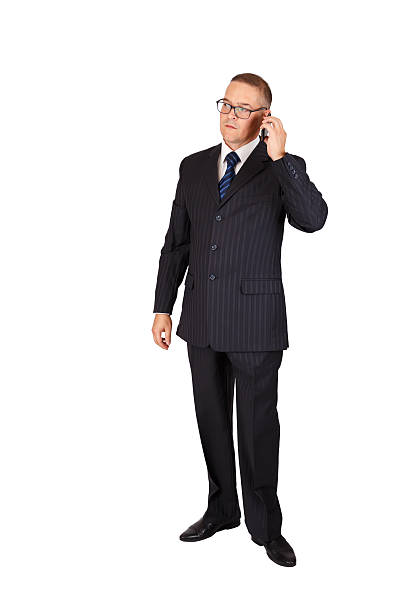 Businessman with serious face speaking on the cellphone stock photo