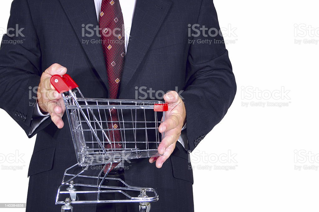 businessman with shopping cart royalty-free stock photo