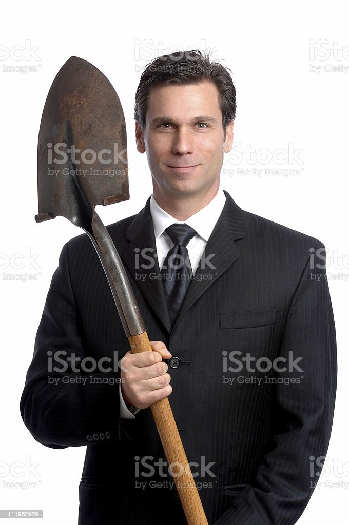Businessman with Shovel Isolated on White Background royalty-free stock photo
